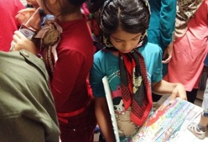 Children looking at books in Read with Me library / Read with Me in Child Foundation - Sep 2015