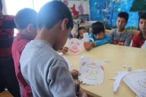 Children making masks for book characters/Read with Me in Ghaennat, Khorasan - Sep 2015