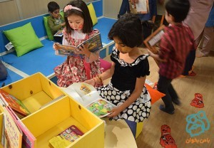 Children looking at books in Read with Me library / Kousha House of Kids - Sep 2015