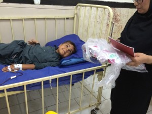 Patient Child in AliAsghar Hospital, Zahedan receiving books from RWM - Oct 2015