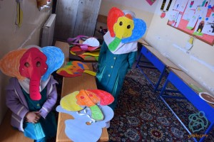 Children making masks for book characters - Read with Me in South Khorasan