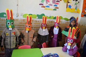 Children playing with masks made by themselves from book characters - Read with Me in South Khorasan - Jan 2016