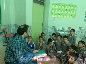 A tutor reads aloud with children - Read with Me in South Khorasan - Jan 2016
