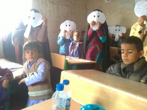Children playing with masks made by themselves from book characters - Read with Me in Zahedan - Jan 2016