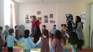 Children playing in a Reading Aloud Session - Read with Me in MahmoodAbad, Tehran - Jan 2016