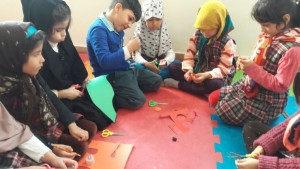 Children making crafts related to books - Read with Me in MahmoodAbad, Tehran - Jan 2016
