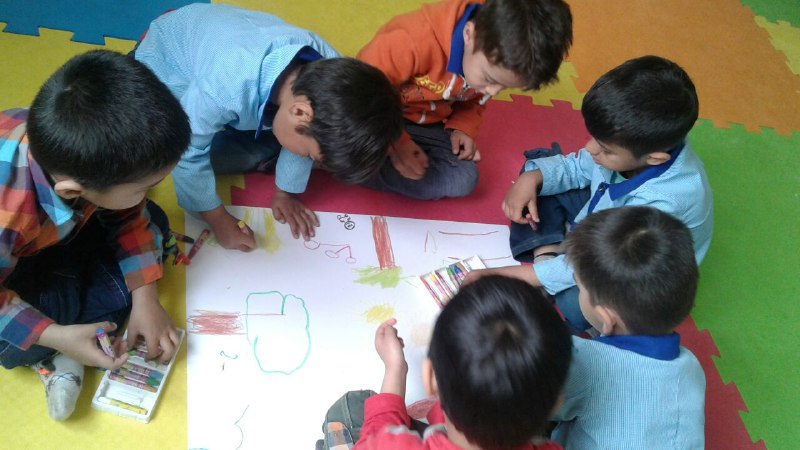 Children drawing book scenes - Read with Me in MahmoodAbad