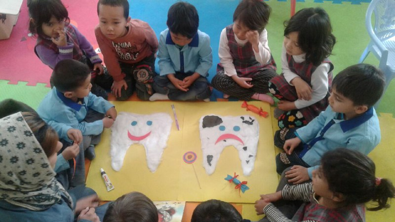 Children making crafts related to books - Read with Me in MahmoodAbad