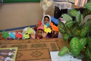 Children playing with finger puppets of book characters - Read with Me in Boshrouyeh - April 2016