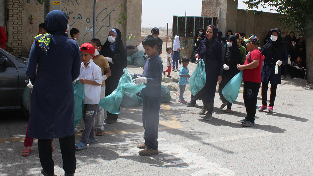 Children participating in litter pickup on World Environment Day - Read with Me in MahmoodAbad - June 2016