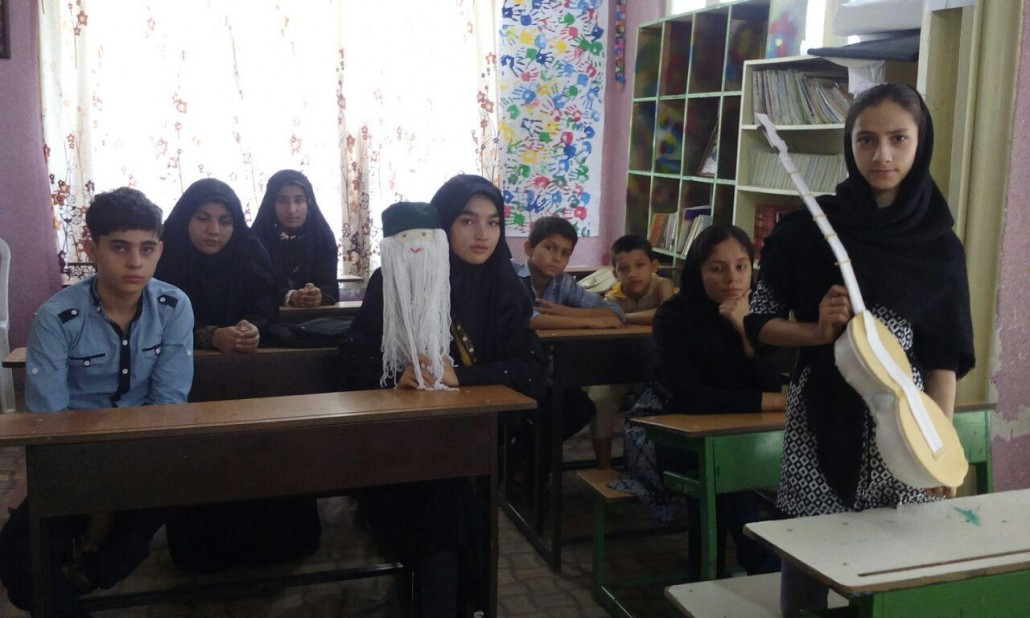 Children taking part in book related activities - Read with Me in Ava-ye-Mandegar, Tehran - July 2016