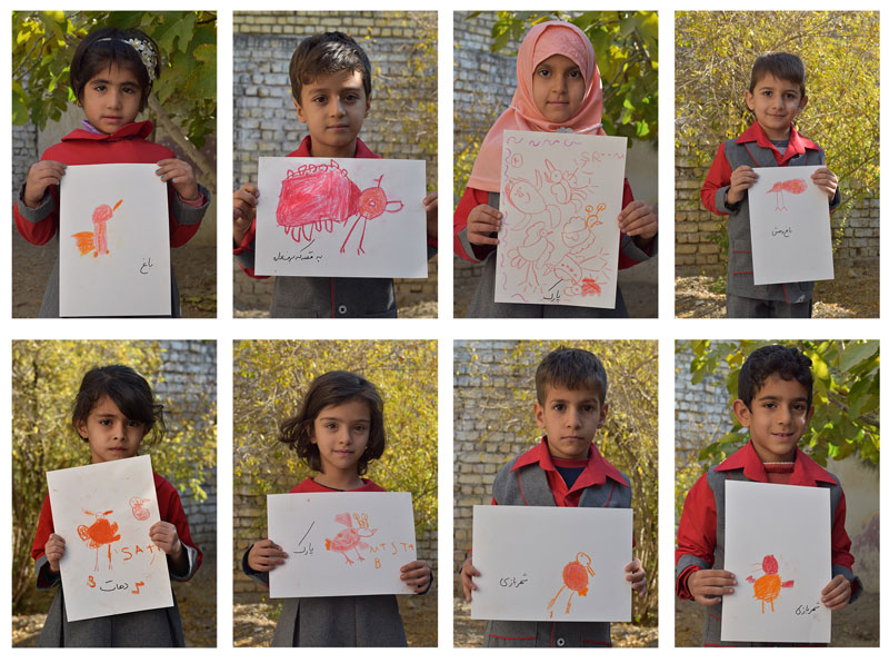 Children holding their drawings in The Red Bird Workshop - Read with Me in Hasseh, Isfahan - November 2016