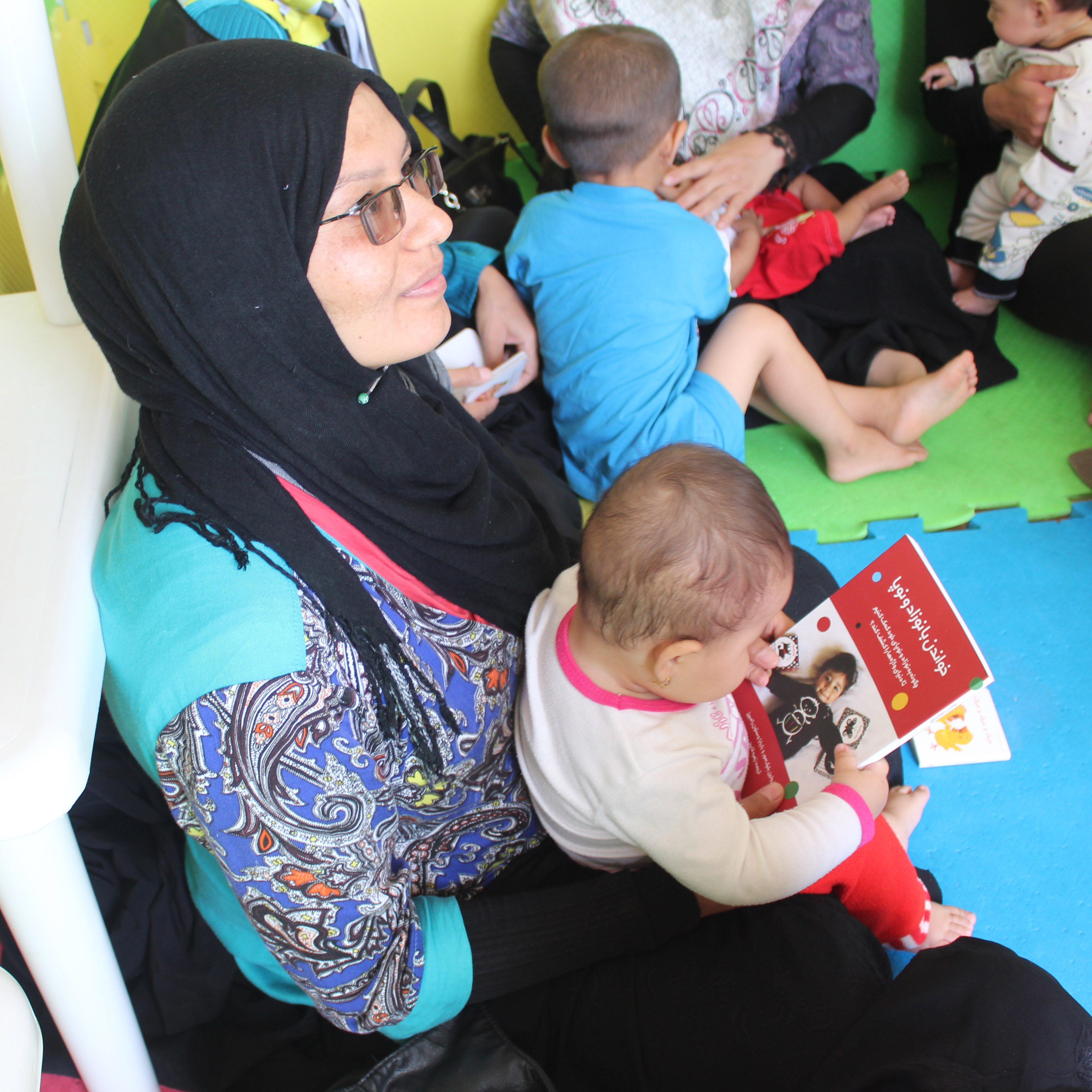 A Mother in babies and toddlers workshop - Read with Me in MahmoudAbad