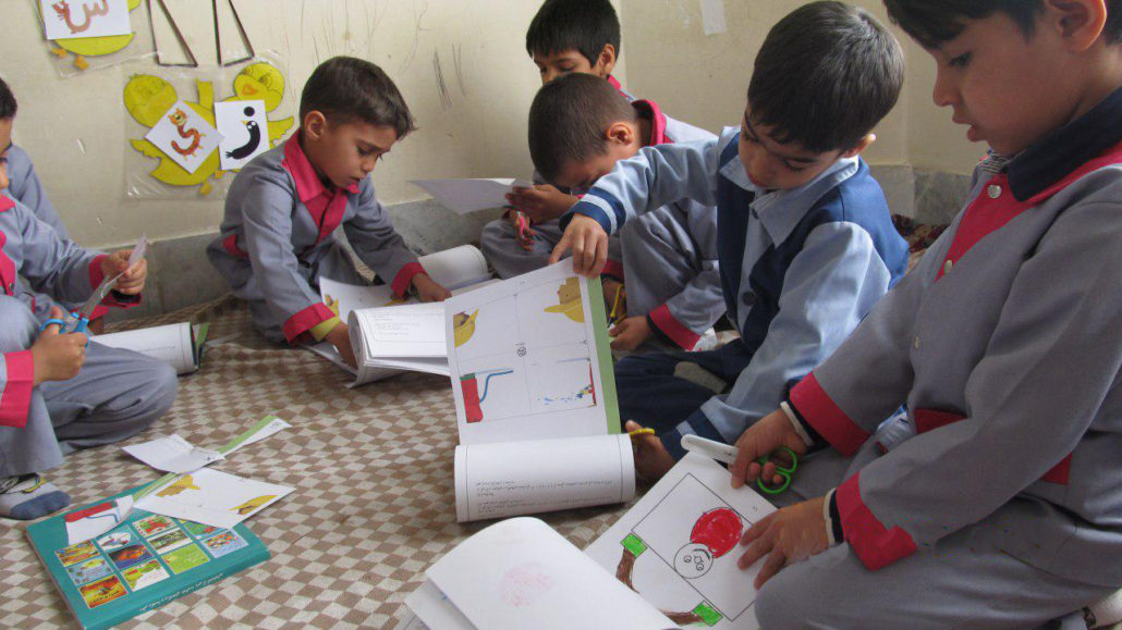 """Finding the word """"Firefighter"""" in Dictionary of Picture Riddles and doing the follow-up activities - Read with Me in South Khorasan - January 2017"""