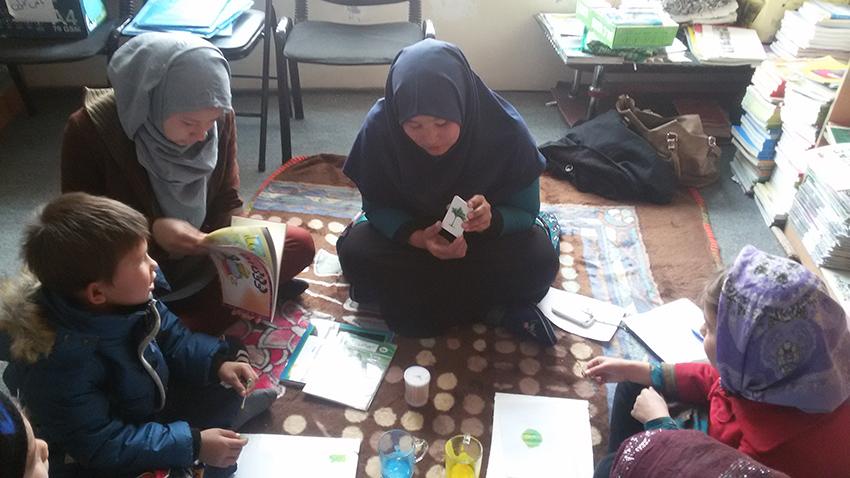 "A RWM trainer works on ""Learning Math package"" with children - RWM in Mazar-e-Sharif (2016)"