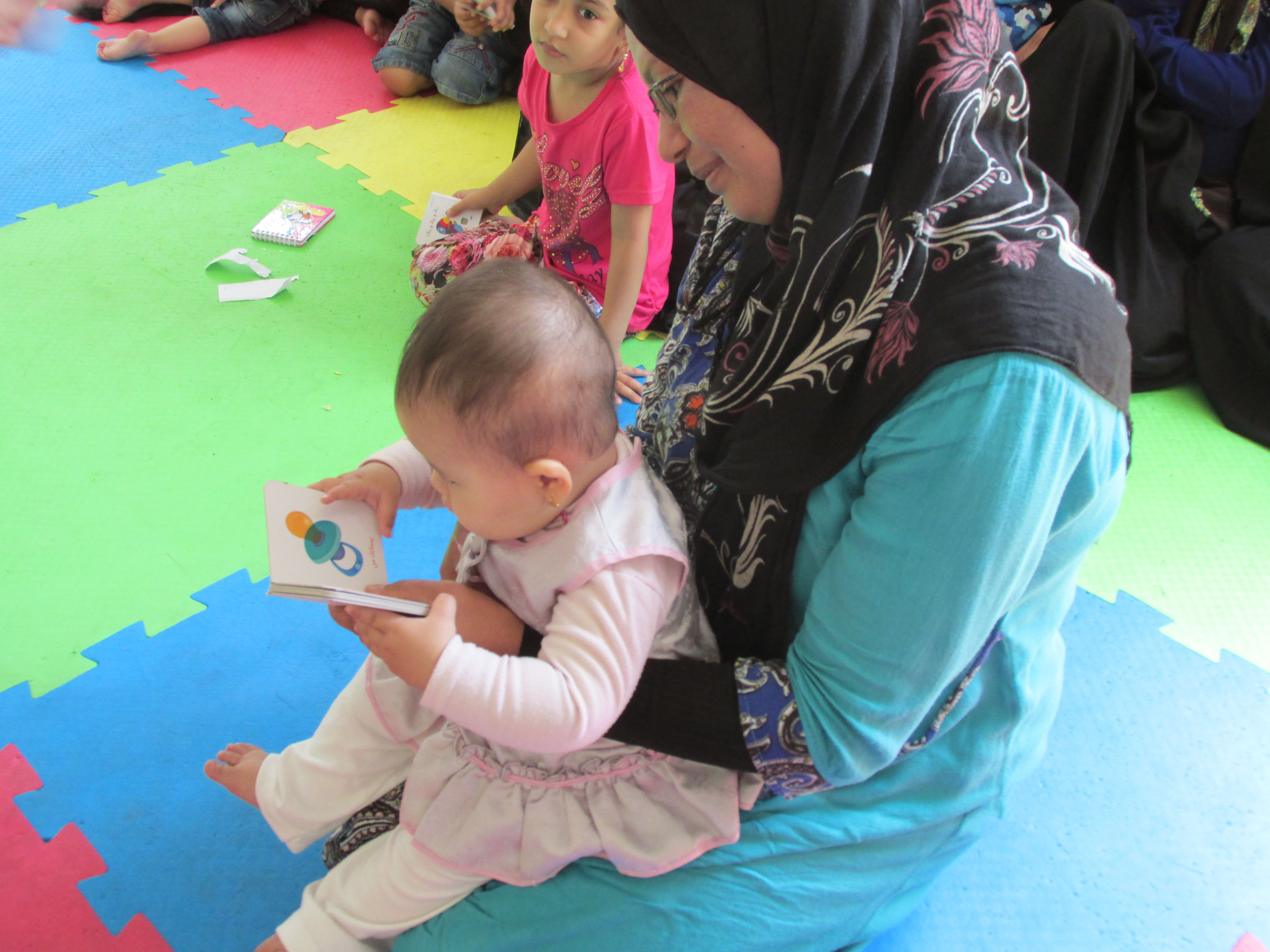 A mother and her child in Reading with Babies and Toddlers workshop - Read with Me in MahmoudAbad