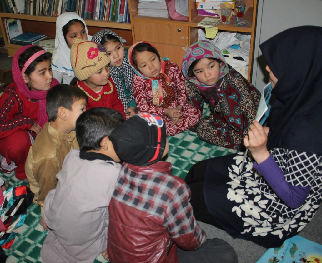 "Pictures from the book ""How To Heal A Broken Wing""  have captivated the children's attention - Read with Me in Mazar-e-Sharif, April 2017"
