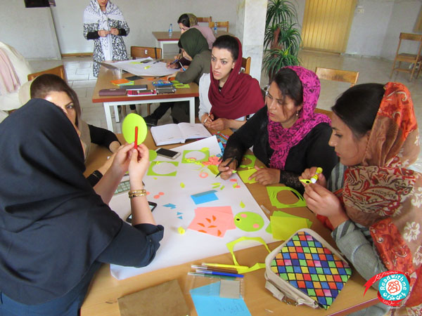Participants learning book-related artistic activities